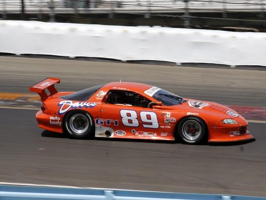 Scott Quaile steers his Chevy Camaro through Turn 1