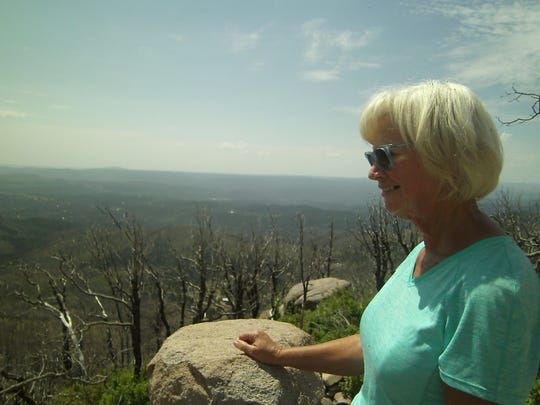 """""""I never would have seen this without Trail Snails."""" New Trail Snail hiker Deb from Possum Kingdom in Texas marvels at the views from Monjeau Lookout in the White Mountain Wilderness."""