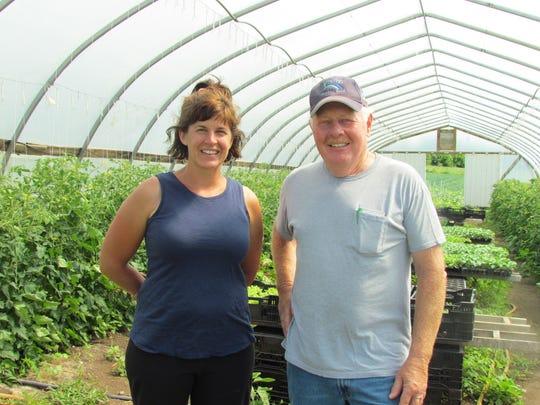 Wayne Hass poses with Robyn Calvey, of Park Ridge Organics, his mentor.