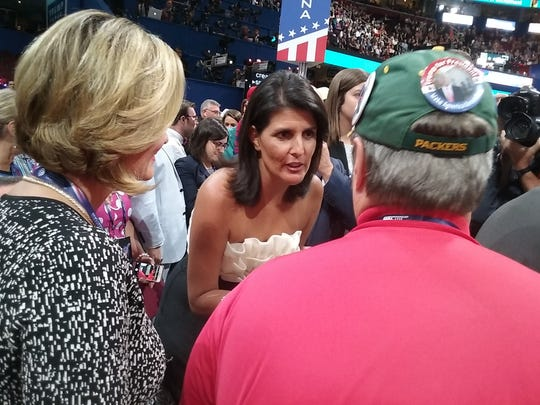 Paul Tittl (back to camera) provides advice to South Carolina Gov. Nikki Haley on the floor of the Republican National Convention.