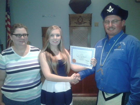Cierra Gadd receives the scholarship certificate from