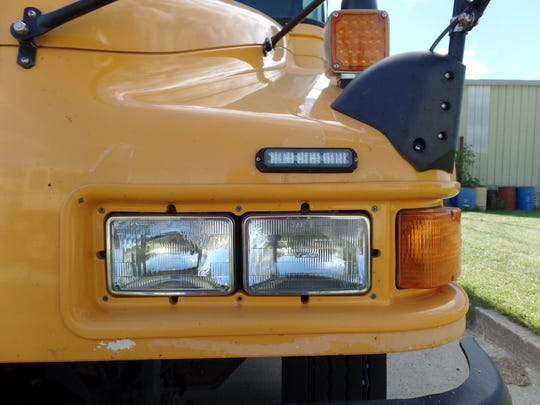 Additional LED lights (top) that are at eye-level of car drivers are being piloted as a safety measure by the Iowa Department of Transportation.