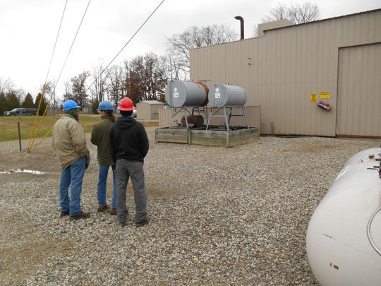 A photo of the now-demolished Merit Energy natural-gas
