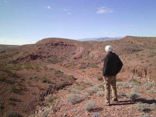 Roger admires the red Abo Formation at Stop No. 1.