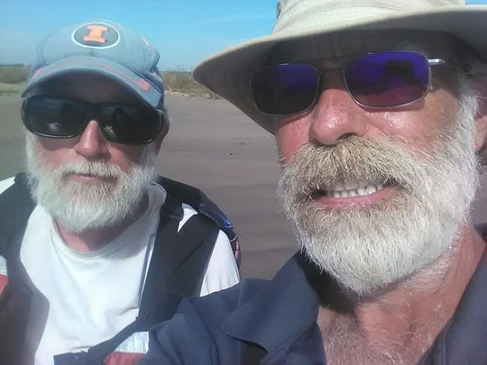 Dave Randolph of Clinton, Illinois, and Mike Malott, of Hartland Township, ended their kayak journey down the Mississippi River on a sandbar in the Gulf of Mexico.