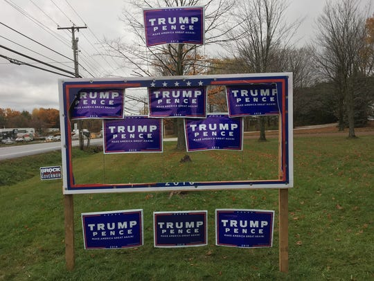 A display of Trump signs in Williston has been vandalized