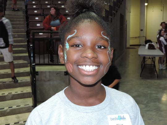 Skiya Washington had her face painted at the Beds 4 Kids event on Nov. 4 at JQH Arena. She was among the 50 area kids who received new twin bed sets.