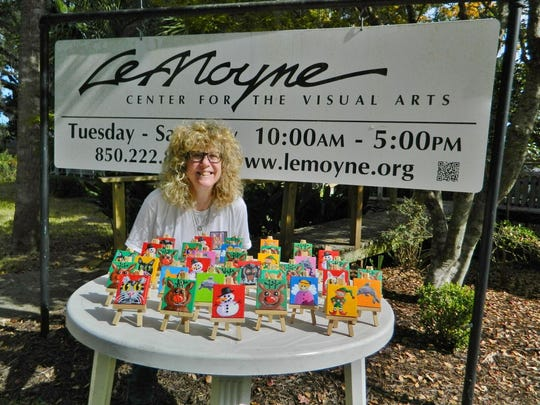Diane Dyal with some of her mini paintings at LeMoyne