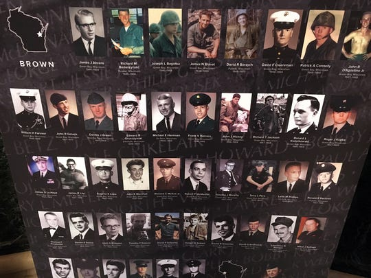 """Banners in the """"Wisconsin Remembers"""" exhibit put a face on the 1,161 soldiers who died during the Vietnam War."""