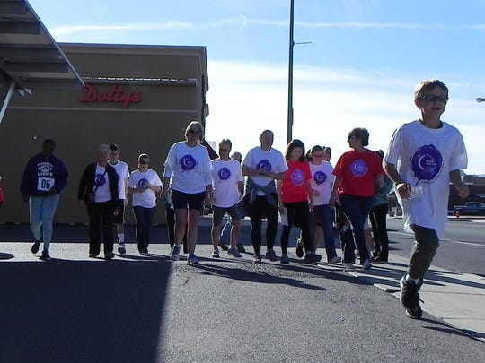 Participants begin the American Cancer Society Relay for Life event Saturday morning.