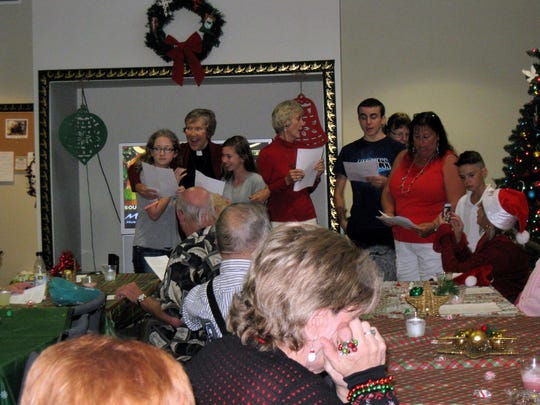 Christ the King church members enjoy leading a Christmas carol sing-a-long with residents of By the River on Dec. 15 in Sebastian.