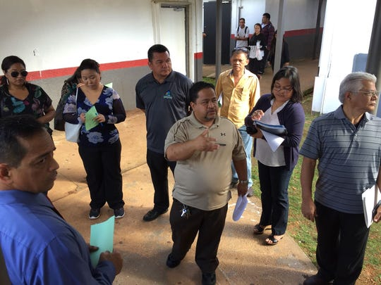 In this Feb. 2, 2017, file photo, education officials, along with officials from the Department of Public Works, do a walk-through at Simon Sanchez High School.