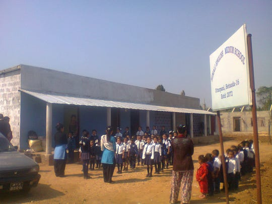 Students line up outside the new school Terry Mikeska visited in Nepal recently.