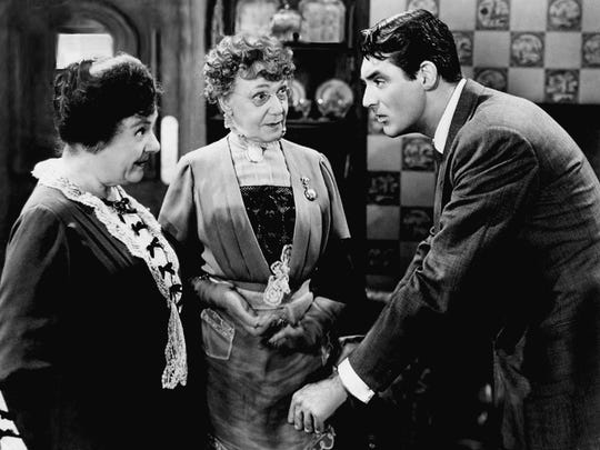 "Mortimer Brewster (Cary Grant) learns his aunts Abby (Josephine Hull, left) and Martha (Jean Adair) have a habit of murdering men in 1944's ""Arsenic and Old Lace."" © Warner Bros."