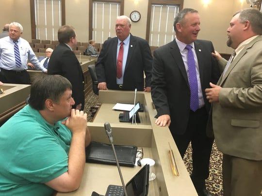 County Mayor Jim Durrett talks with Commissioner Brandon