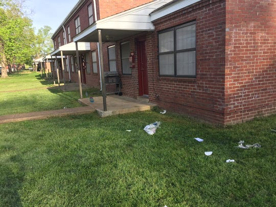 The scene of a shooting at Lincoln Homes in Clarksville in November 2015, with the remnants of EMS supplies on the lawn
