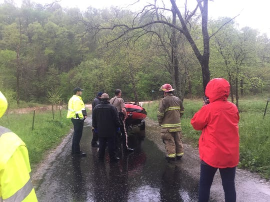 Rescuers at the scene in eastern Christian County after