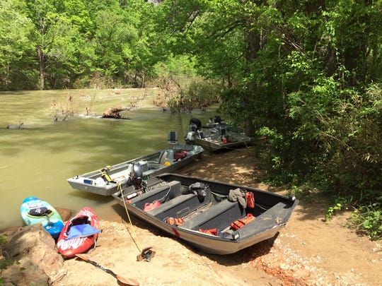 Rescuers used kayaks, canoes, powerboats and shore searches Thursday in hopes of finding a missing paddler on the Buffalo River.