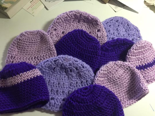 Members of the Women's Club of Franklin Township made these purple baby hats for the Click for Babies Campaign.