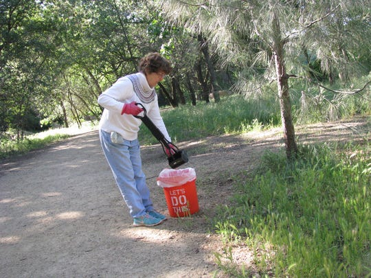 Liz Jacobs of Redding volunteered Wednesday to clean up dog doo at Turtle Bay East park as part of a cleanup organized by the Shasta Dogs group.