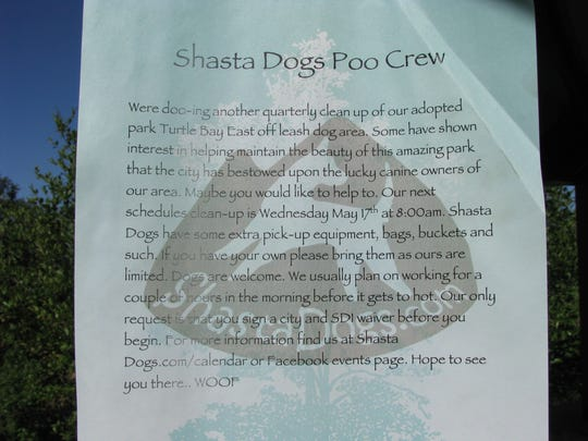 A sign was posted at the Turtle Bay East gazebo inviting people to volunteer to join the dog doo cleanup Wednesday.