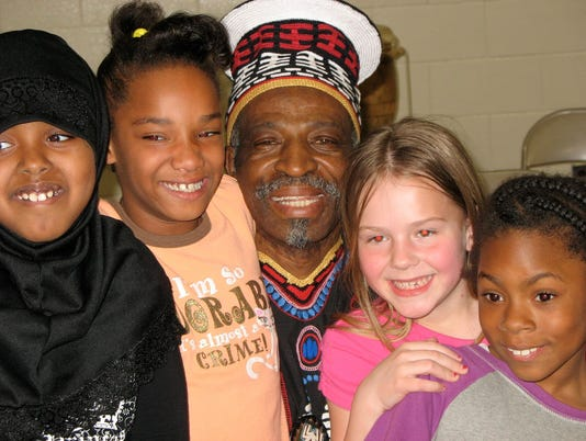 636332375190102127-0622-Fred-Yiran-with-Madison-students.jpg