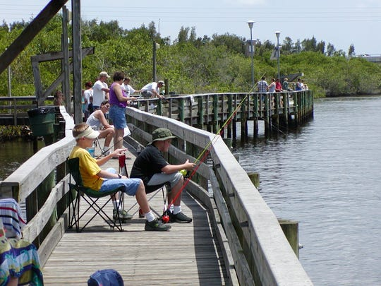 Anglers fish from the Veterans Memorial Park boardwalk