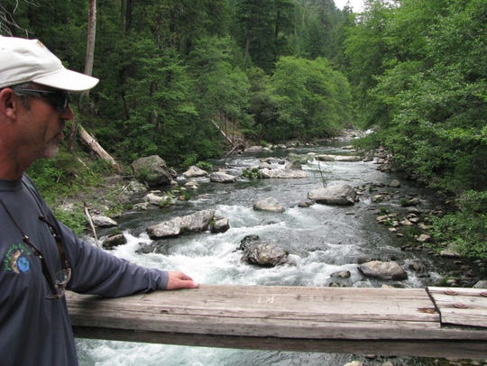 Jack Trout looks at a section of the McCloud River
