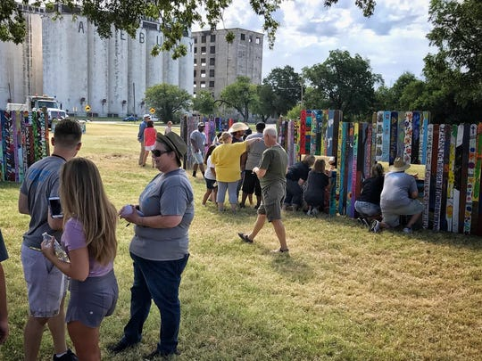 The Wichita Falls Alliance for the Arts and Culture unveiled the Don't Fence Me In project Saturday, a collaboration among community participants created with 1,200 donated pickets.