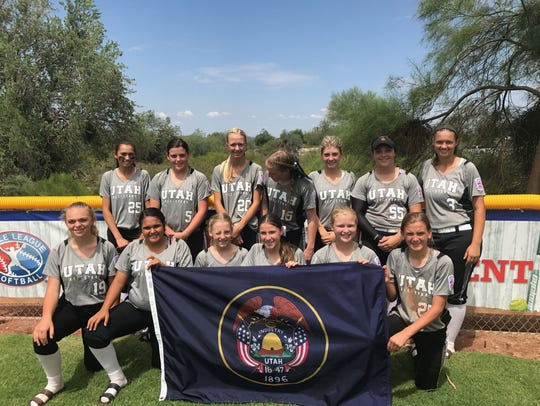 The 14U Cedar American softball team poses for a picture