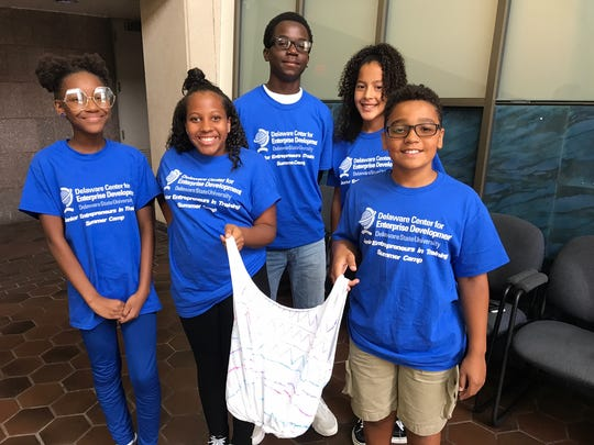 From left to right: Sariah Shrouder, Elise Sampson,   Tyshawn Elzey, Mariah Street and Cameron Taylor produced the T-Bag for Market Day Friday.