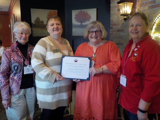 As pictured, Grace Berg (center right) was presented a letter from the International President, by GFWC-WI President Susan LaBuda (second from left). Others pictured are Mary Fortier, district president (at left), and Karen O'Strowski, district secretary (at right).