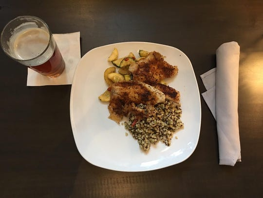 The blackened tilapia over pesto Israeli couscous at