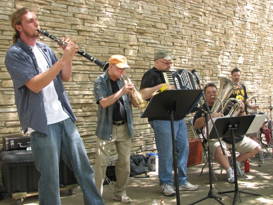 From left, Daniel Menzel on clarinet, Mark Finkelstein on trumpet, Abe Goldstien on accordion, John Manning on tuba and Kurt Bowermaster on drums perform with Bob Marion (not shown) on mandolin as the Java Jews, a Des Moines band that plays traditional klezmer music.
