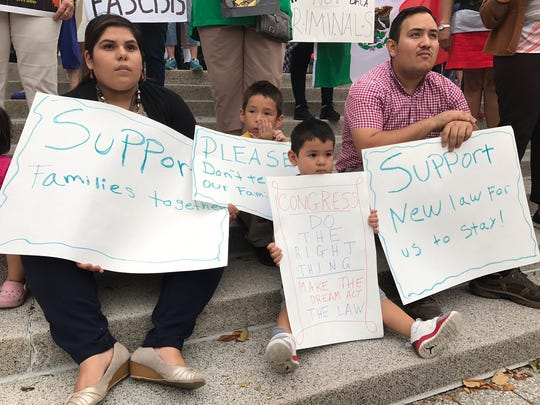 Protesters rallied in Wilmington's Rodney Square Tuesday night, hours after President Donald Trump's decision to end the DACA program, which protected young undocumented immigrants from deportation.