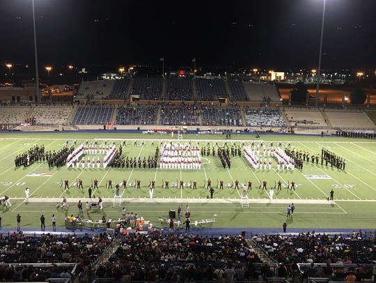 The Abilene High band, in black, joins the Midland