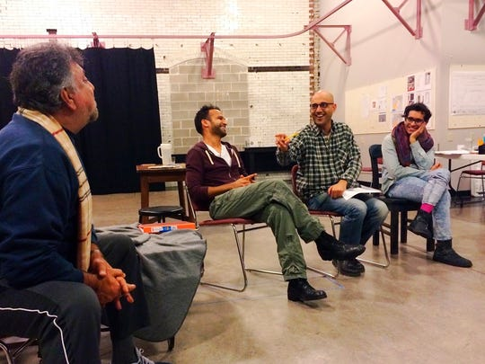 Playwright Ayad Akhtar (second from right) jokes with