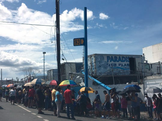 Lines to get ice in Bayamon, Puerto Rico, on Sept.