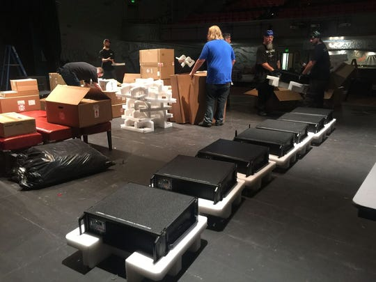 Workers unpack components of the theater's new $500,000 sound system.