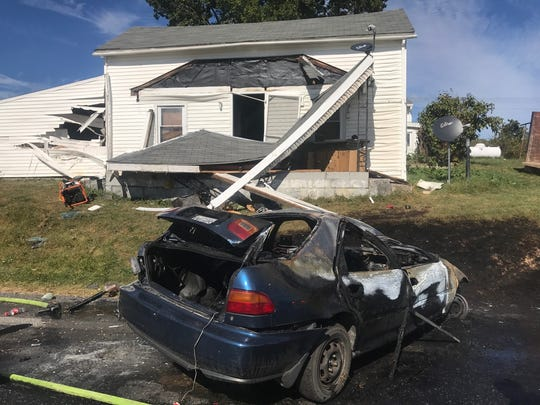 The damaged house and car after a one-vehicle wreck on Hewitt Road on Friday, Sept. 29, 2017, in Swoope, Va.
