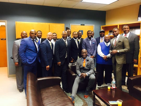 Marvin Boatman, (sitting down, center) founded the