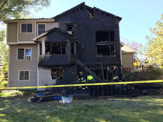 The back of a home west of Fort Collins was fully engulfed