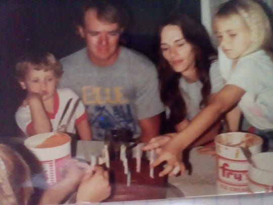 Mark and Nora Nemmers pictured with their children in an undated photograph. Nora Nemmers died in 2016 at the age of 53 due to heat-related causes.