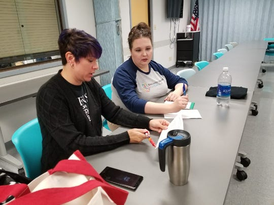 Crystal Henson, left, and Angela Herrera, right, hold a Sandusky County Breastfeeding Coalition meeting at the Sandusky County Health Department.
