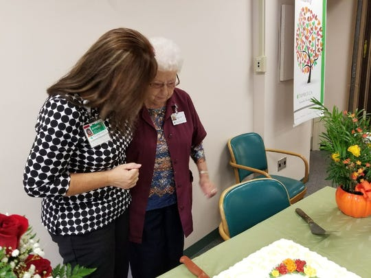 """Annette Overmyer, director of Golden Threads Senior Program, wishes Myrtle Koch a happy birthday. Overmyer called Koch """"the kindest, sweetest person."""""""