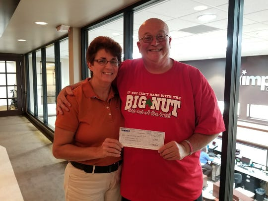 """Terese and Jon """"Big Nut"""" Peters of Fremont donate $51,000 in scholarship money to the Ohio State University."""