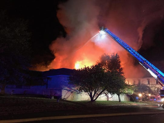 An early-morning fire Tuesday heavily damaged the vacant