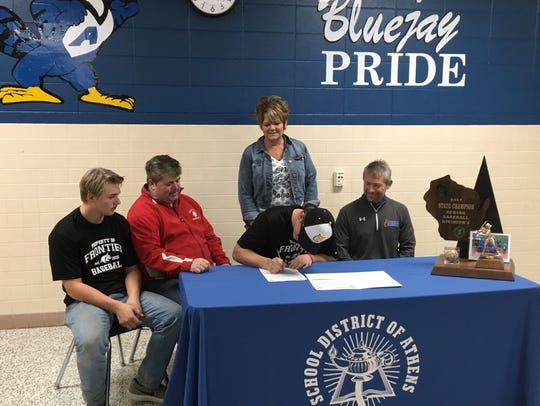 Athens' Marshall Westfall signs his letter of inent