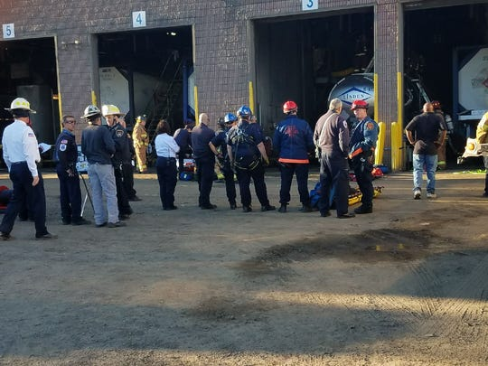 Emergency personnel worked to rescue a man trapped