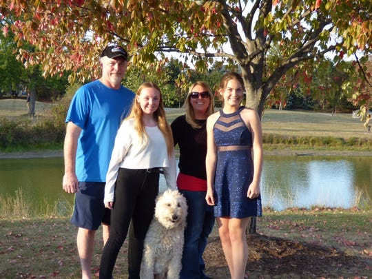 Makenzie Carpenter (right) with her her father Doug, sister Chelsi, mother Lori and the family dog.
